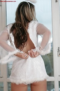 Angel Olivia Sultrily Kneels Against The Window As She Uncover Her Panties