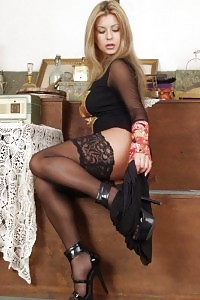 Titty Blonde In Black Stockings Teasing And Unclothing Herself