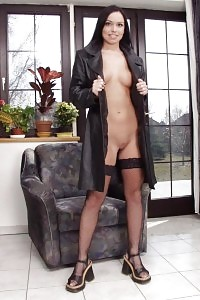 Aggressive Brunette Siren Walking Nude With Only Stockings And Trench Dress On